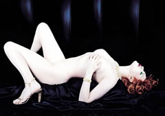 Yves Saint Laurent Opium perfume advertisement featuring a naked Sophie Dahl